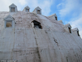 Frozen in time: The crumbling concrete 'Igloo City' hotel in Alaskan wilderness that has become a major tourist attra...