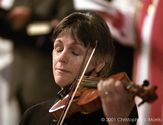 Violinist Nancy Dinovo cries while playing during a service at Christchurch Cathedral in Vancouver for the victims of...