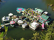 Couple Lives Off The Grid After Spending 20-Years Building Self-Sustaining Floating Island