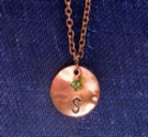 http://www.suzannamcmahan.com/#!product/prd1/3338948051/initial-charm-necklace-in-copper