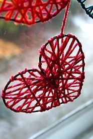 DIY Yarn Hearts To Decorate Windows On Valentine's Day - Shelterness