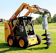Digging Made Easy with Skid Steer Auger Attachments