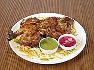 tandoori chicken with mint chutney and onion