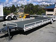 What are the pros and cons of using a tri axle trailer?