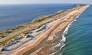 Outer Banks is located in North Carolina and is a natural beach with plenty of big houses to rent