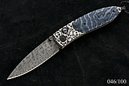 "William Henry B05 Monarch ""Departure"" with Silver Skulls, Fossil Coral, and a Hornets Nest Damascus Blade"