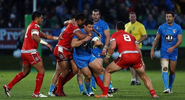 Tonga's defensive display eliminates Italy