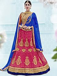 Fetching blue and pink ceremonial wear net bridal lehnga choli