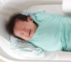 Baby laughing while sleeping