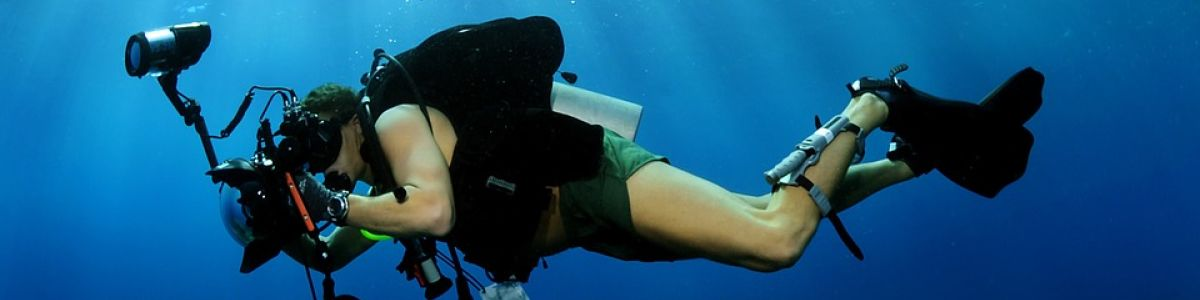 Headline for Underwater Photography Tips - Shirts off, lenses on!