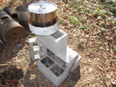 Simple pot skirt on Rocket stove for higher efficiency