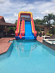 20 feet tall water slide into a pool