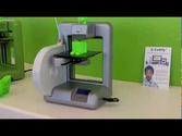 3D printer in action making real 3D models - can make shoes, guns - anything!