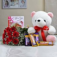 Buy/Send Bunch of 10 Red Roses with 12 inch Teddy Bear - YuvaFlowers.com