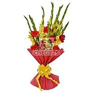 10 Yellow Glads with 6 Red Carnations in a Red Paper Packing.