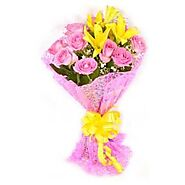 12 Pink Roses in and 2 Yellow Lilies in cellophane packing.