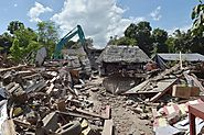 Quake cuts power topples buildings on the Indonesian island