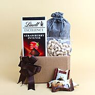 Website at https://www.oyegifts.com/lindt-excellence-strawberry-and-al-alwani-dates-with-cashew-nuts