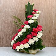 Buy or Order Swirling Red and White Carnations Basket Online - OyeGifts