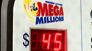 Kansas man claims $50M Mega Millions jackpot on ticket he purchased in Missouri