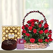 A beautifully arranged basket with Red Roses and Ferrero Rocher & Cake with Spacial Greetings