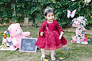 First birthday party of 'lil M, an outdoor party with a butterfly decor