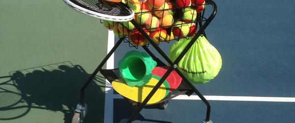 Headline for 10 Dead Giveaways This Is A 10 and Under Tennis Teaching Cart