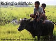 Riding a Buffalo by Yogi Nainggolan & Taruli Tambunan