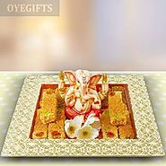 Order GANESHA IDOL & MILK CAKE HAMPER Online Same Day Delivery - OyeGifts.com
