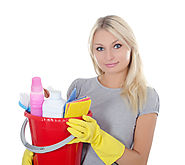 Blonde Lady with gray shirt and yellow gloves holding red bucket of cleaning supplies
