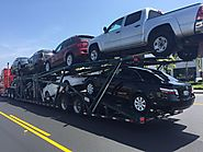 How to Choose Between Towing your Vehicle or Auto Transport?