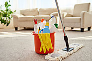 Red bucket with gloves and cleaning supplies with mop