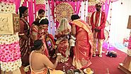 Hindu wedding ritual of presenting a gold coin