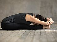 Steps & Benefits of Paschimottanasana (Seated Forward Bend)