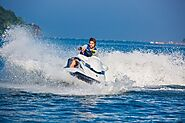 Speed through the waters on a jetski